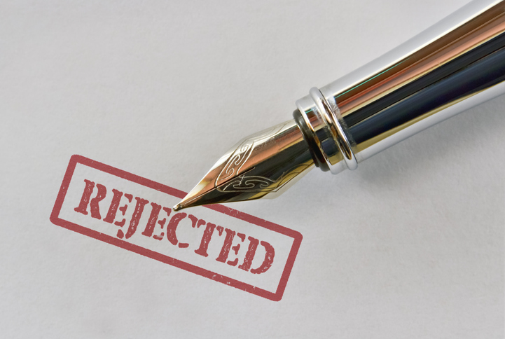 Closeup of a fountain pen and word Rejected on bright background