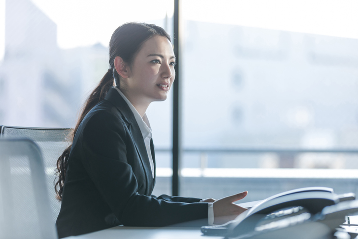 Businesswoman working in the office. Positive workplace concept.