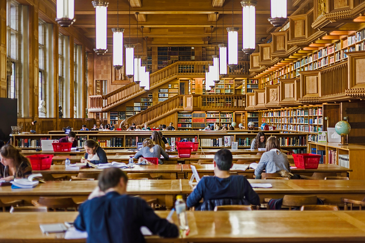 Leuven, Belgium - October 14, 2015: Students who studying inside the library of the university of Leuven, Belgium, old from the years 1425.