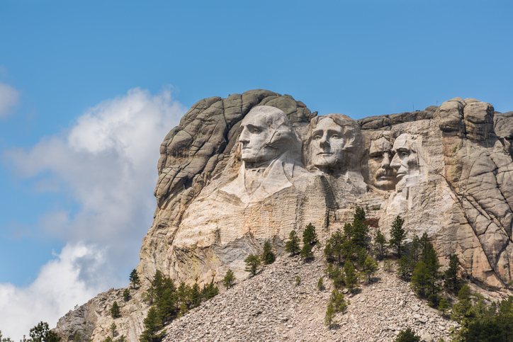 Side view of public monument Mount Rushmore with sunlight